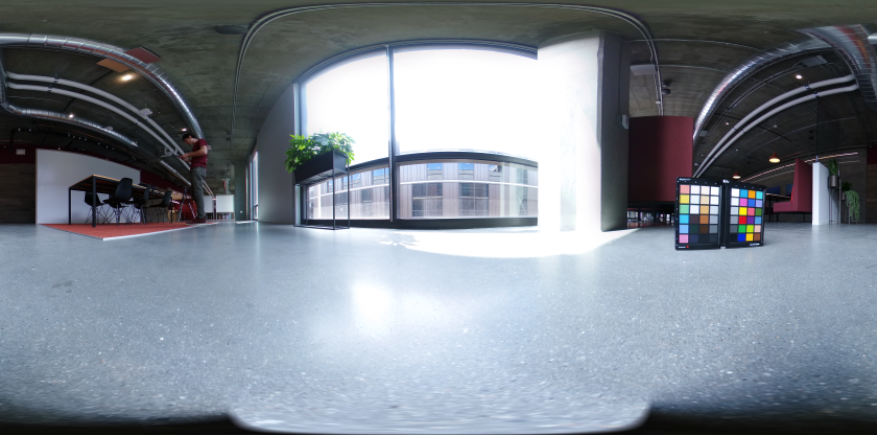 A 360 degree HDR panoramic of an office space with a color chart in the foreground