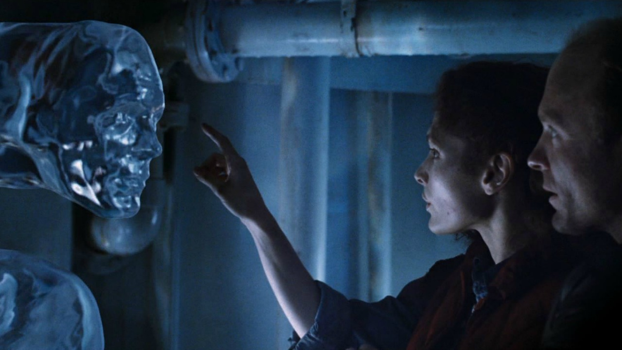 A scene from James Cameron's The Abyss in which Mary Mastrantonio reaches out to touch the CGI water tentacle